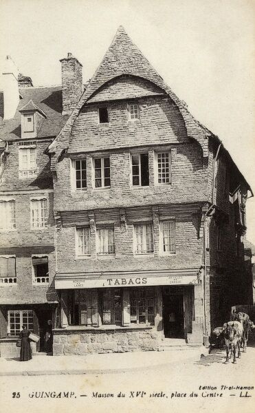 Tabacconist on the Central Square at Guingamp, France. A four-level house of the 16th century, covered in exterior wall shingling. Date: circa 1910s