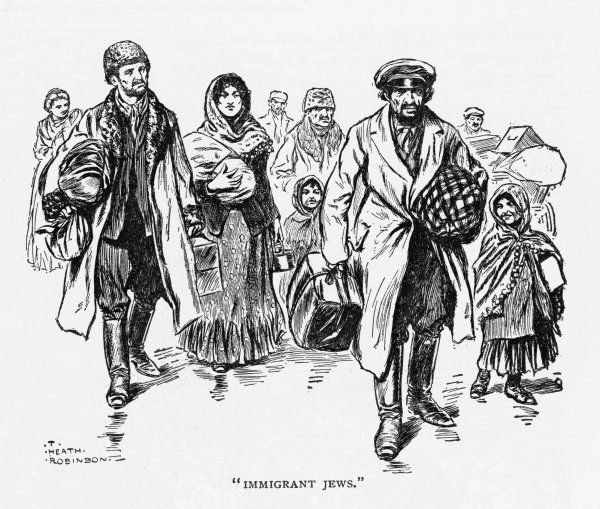 Jewish men, women and children arrive in London carrying their possessions in suitcases and bundles