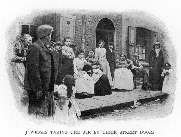 Members of the Jewish immigrant community gather outside their homes in Whitechapel, East London