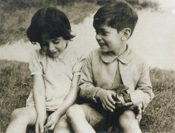 Two young Jewish children sit together in Germany during the early years of the Third Reich