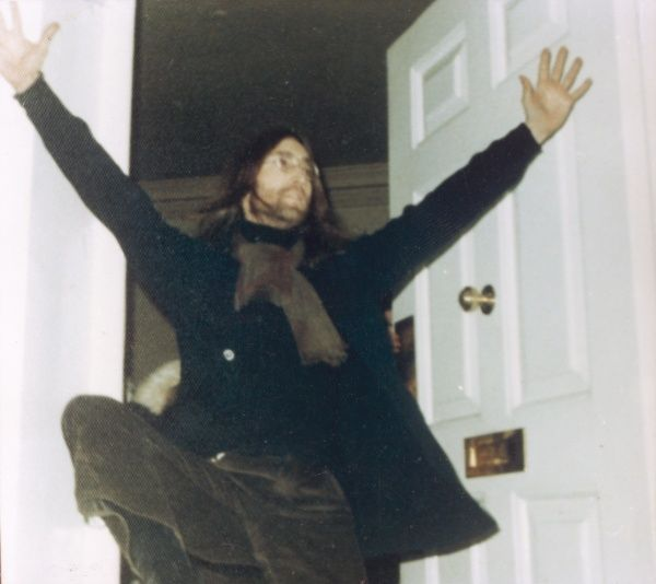 John Lennon, member of The Beatles getting a bit excited outside his front door