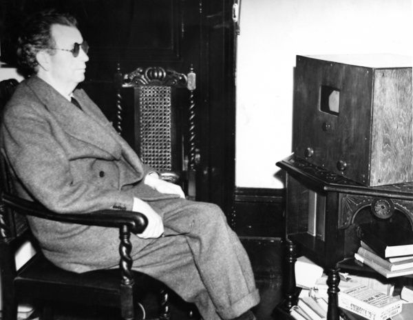 Photograph showing John Logie Baird (1888-1946), the Scottish electrical engineer and television pioneer, watching 'stereoscopic' television at his home in Sydenham Hill, London, June 1942