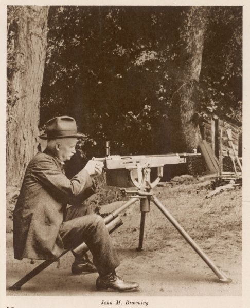 JOHN MOSES BROWNING American inventor of automatic pistols, rifles etc : shown with one of his machine guns