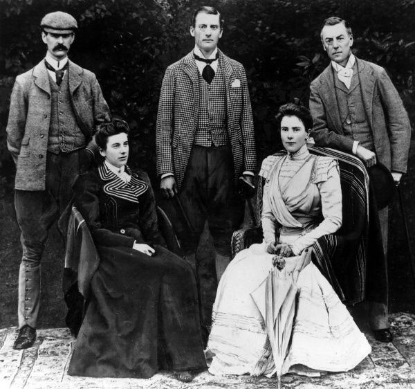Photograph of the Chamberlain family after Joseph Chamberlain's marriage to Mary Endicott, 1889. Back row, left to right: Neville Chamberlain (1869-1940), Austen Chamberlain (1863-1937) and Joseph Chamberlain (1836-1914). Front row, left to right: Miss H