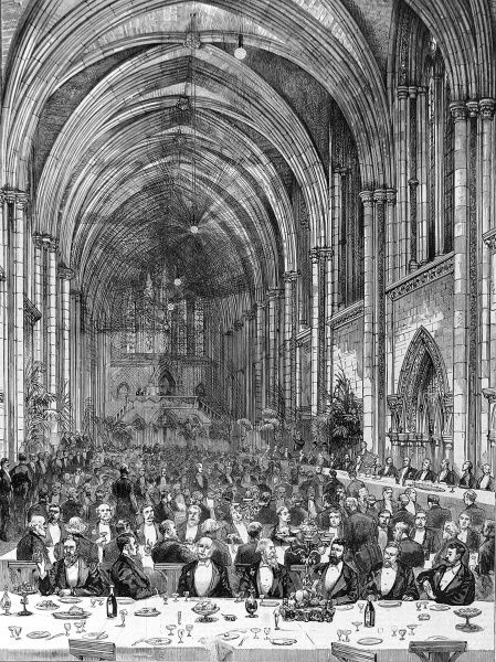 A Jubilee Banquet of the Incorported Law Society in the Central Hall, Royal Courts in 1887 showing rows of tables, attending waiters and the toastmaster in the background