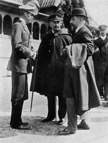King Haakon of Norway (1872 - 1957), formerly Prince Carl of Denmark pictured talking with Kaiser Wilhelm II of Germany and the Norwegian Prime Minister, Michelsen in 1909