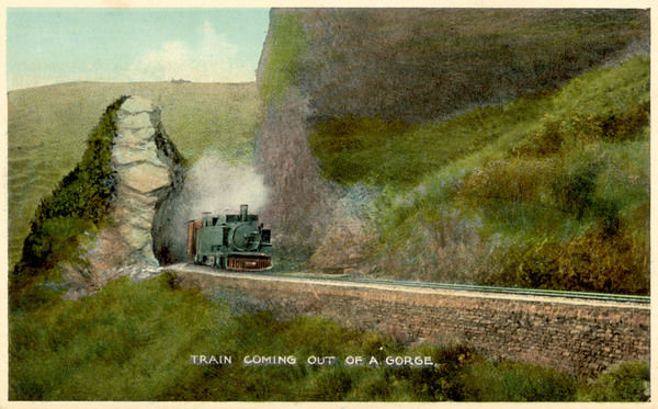 View on the Kalka to Simla Railway in northern India : a train emerges from a gorge