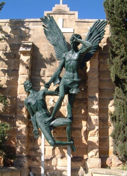 Green angel figures outside Kappella Madonna tal-Paci, Hal-Far, Malta
