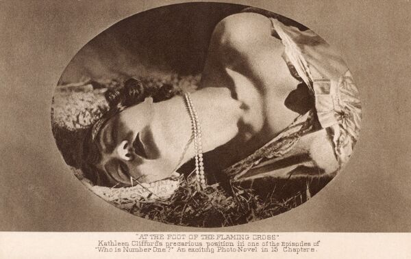 Still from Paramount Picture Production 'Who Is Number One?' - starring Kathleen Clifford (1887 - 1962) in the role of Aimee Villon. Here the star appears to be in perilous position, although it looks more like the ecstasy as well as the agony