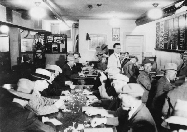 'Divorce City' makes gambling legal! The popular game of KENO being played in a gambling house in Reno, Nevada, U.S.A. Date: 1930s