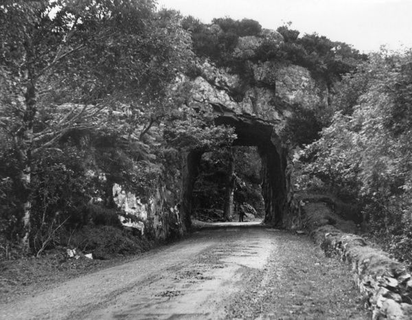 A tunnel cut through rock on the Kenmare Road, on the way to the Gap of Dunloe, Killarney, County Kerry, Ireland. Date: 1930s