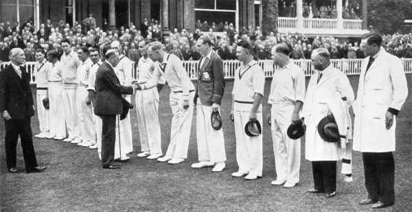 King George V, accompanied by Lord Cromer, President of the M.C.C and Mr. R.E.S Wyatt, the captain, shakes hands with the English cricke players at Lord's. Left to right are:- Mr. C.F Walters, H. Sutcliffe, Mr. K Farnes, W.R Hammond, L.E