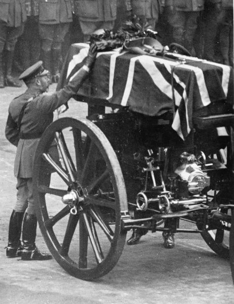 King George V placing a wreath on the coffin of the Unknown Soldier during the procession to Westminster Abbey, on 11 November 1920