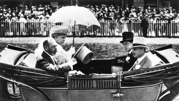 King George V and Queen Mary at Ascot in the early 1930s, riding in a carriage with their sons Edward, Prince of Wales (in black) and Prince Henry, Duke of Gloucester