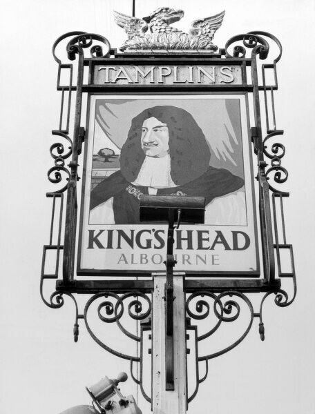 The well-painted inn sign of the 'King's Head' (King Charles II), public house, at Albourne, Sussex, England. Date: 1950s