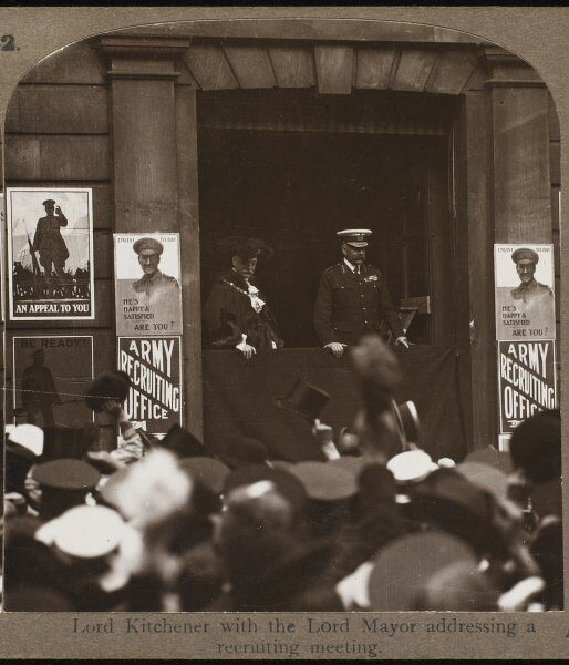 Lord Kitchener addressing would-be recruits at a meeting accompanied by the Lord Mayor outside an army recruitment office. Raised hats in the crowd suggest enthusiasm