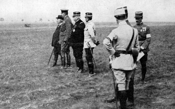Photograph showing the war ministers of Britain and France at an inspection on a visit to the Western front. Lord Kitchener is seen second from left, and General Joffre third from left. Millerand, the French war minister if far left