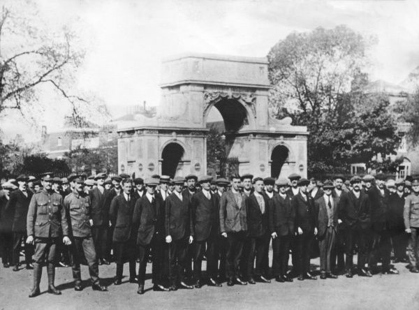 Kitchener's army recruits at the Royal Engineers Barracks in Chatham, Kent, during the First World War, with an ornamental stone gateway behind them. Date: 1914-1918