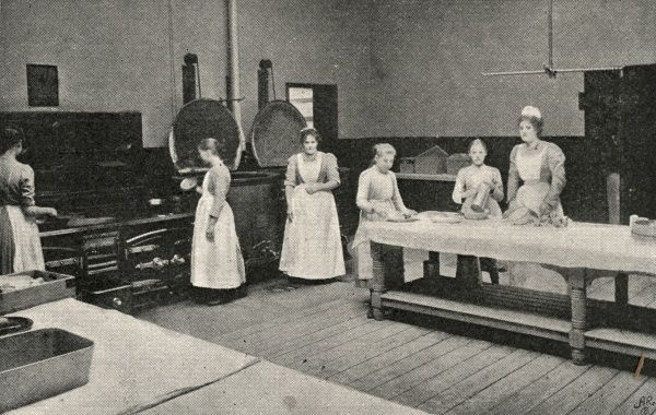 Staff and inmate helpers in the kitchens at the Lambeth Schools for workhouse children on Elder Road, West Norwood, South London
