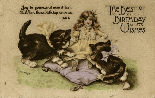 Two kittens playing with a doll on a birthday postcard. Date: 1915
