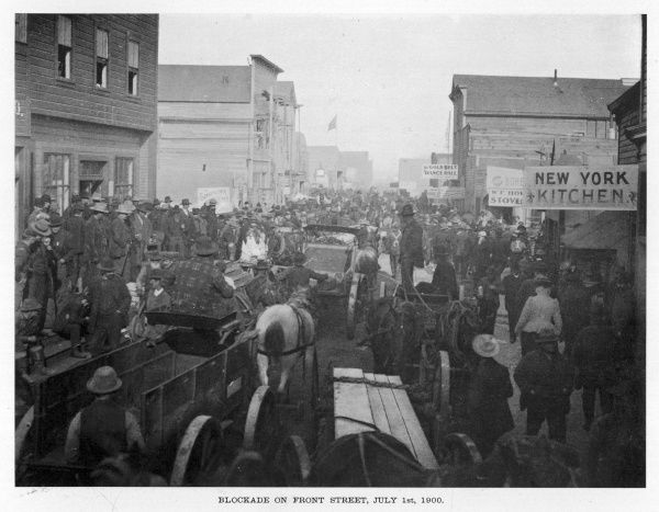 Prospectors crowd Front Street, Nome, Alaska, at the height of the gold rush
