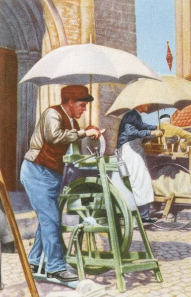 A knife grinder working at Tournai market in Belgium Date: 1950
