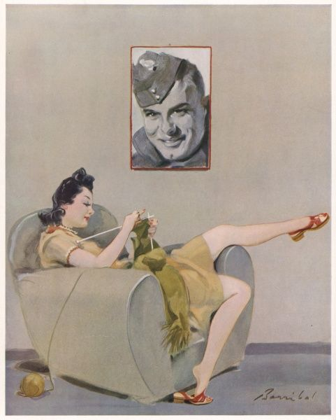 Sassy wartime woman lounging in a chair knitting while a portrait of her boyfriend or husband smiles from the canvas