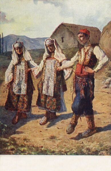 Traditional National Dance of Kosovo - three dancers in full traditional costume perform the 'Kolo' Dance