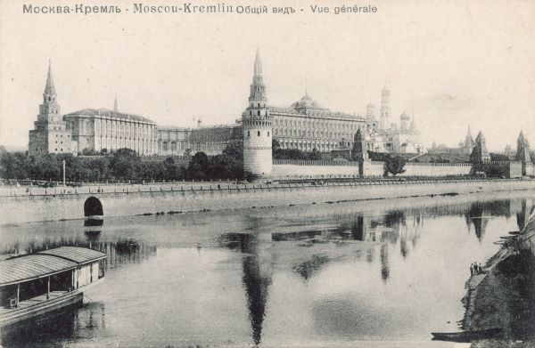 The towers of the Kremlin are reflected in the waters of the Moskva River