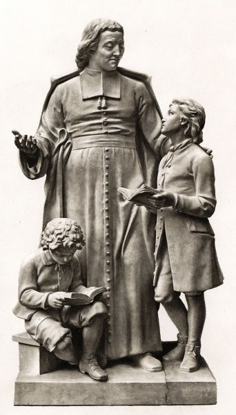 JEAN-BAPTISTE DE LA SALLE French churchman, educator and benefactor, founder of the Freres Chretiens, depicted with two boys whom he helped to educate. Date: 1651 - 1719