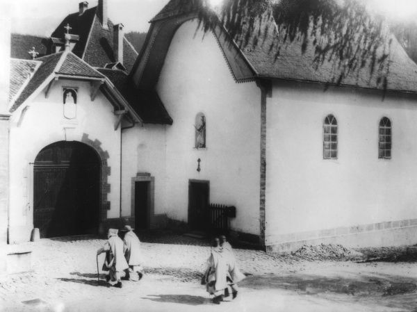 Carthusian monks entering the monastery of La Valsainte, Switzrland. Date: early 1940s