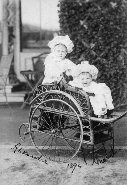The daughters of Princess Louise of Wales, Duchess of Fife, Alexandra (1891-1959) and Maud (1893-1945) perched in a rather elaborate cane carriage