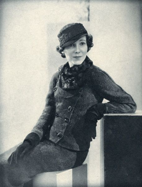 Lady Charles Cavendish, formerly Miss Adele Astaire (sister and dancing partner of Fred) pictured wearing a coat and skirt in green tweed trimmed with galliac, worn with a blouse of black jersey