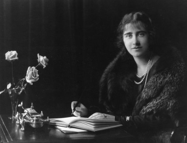 Lady Elizabeth Angela Marguerite Bowes-Lyon (1900-2002), later Duchess of York, Queen Elizabeth and then Queen Mother (to Queen Elizabeth II). Wife of King George VI. Pictured in 1926 at her writing desk