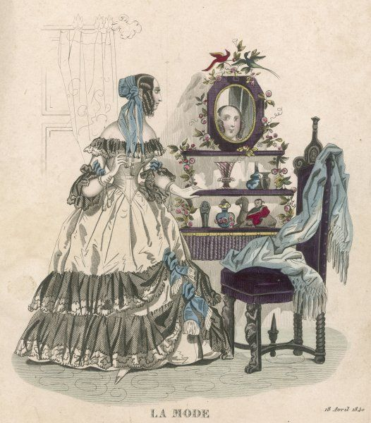 A lady admires her appearance in the mirror which stands on the top shelf of her etagere, which is otherwise filled with ornaments of dubious chic