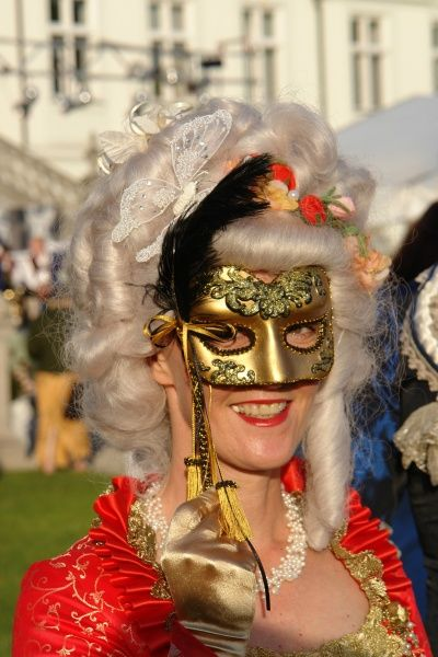 Lady in costume and mask at a rococo festival in Haimhausen, just north of Munich, Bavaria, Germany