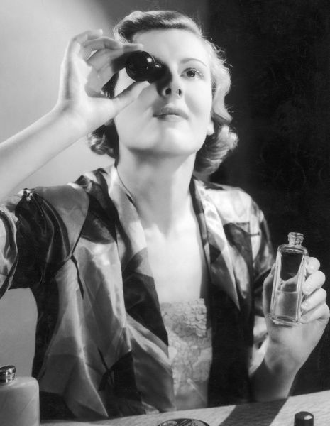 A woman keeps her eyes clean and bright by washing them in an eyebath with a mild solution of rose water and boracic