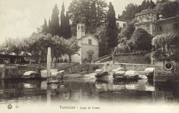 Small fishing and pleasure craft moored up at Tremezzo on the shore of Lake Como, Italy. Date: circa 1910s