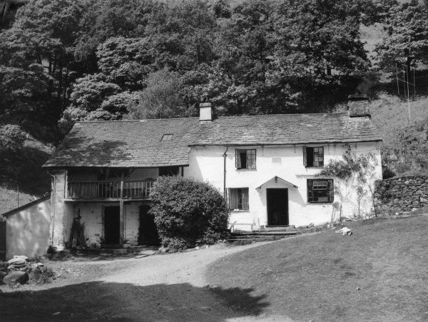 Low Tilberthwaite Farm & Barn, a typical farmhouse in the Lancashire part of the Lake District, England. Note the spinning gallery, used for drying out wool. Date: 17th century