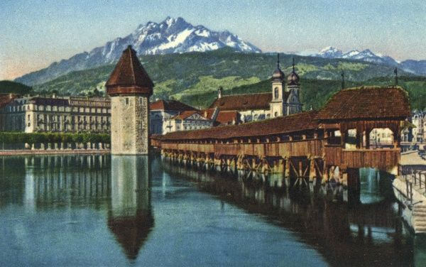 A view of Lake Lucerne, Switzerland, with the Jesuit church in the foreground and the Pilatus mountain in the background (height 2132 metres). Date: circa 1940