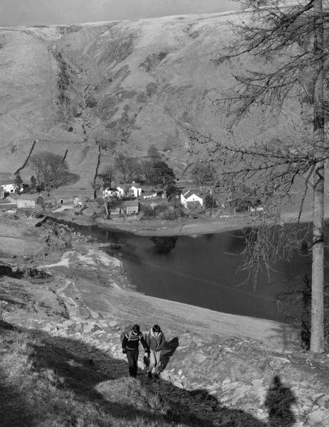 Two ramblers walking in the English Lake Disrrict. Date: late 1960s