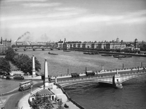 Looking down on Lambeth Bridge and the River Thames from Thames House, Millbank, London, with the Albert Embankment and St. Thomas' Hospital beyond. Date: 1930s