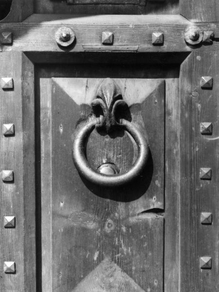 The ancient ring door-knocker at Lambeth Palace, London. Date: 1950s