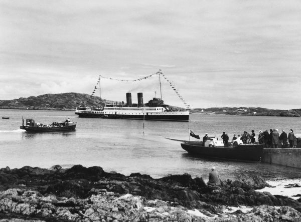 Visitors landing on the Isle of Iona, Scotland