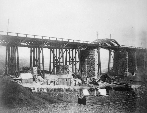 View of construction work on the Landore Viaduct, over the Swansea valley and the River Tawe, on the Great Western Railway, Glamorgan, South Wales. The original timber viaduct was designed by Brunel, and completed in 1852. The new structure