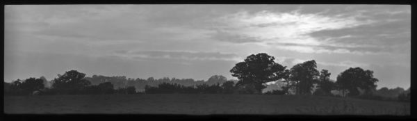 A panoramic landscape with trees on the horizon, near the village of Coopersale, Epping, Essex
