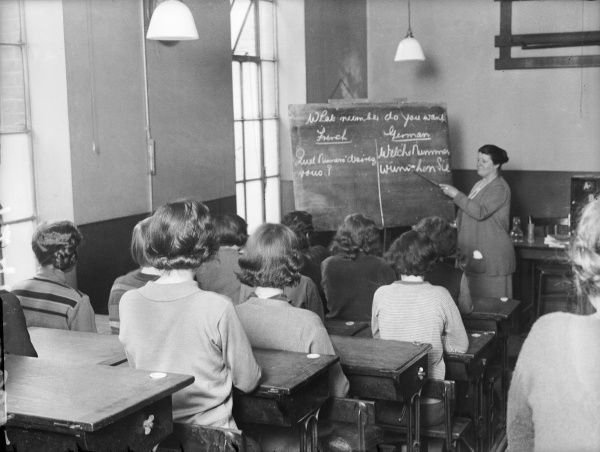 London telephone girls being taught French and German in a classroom