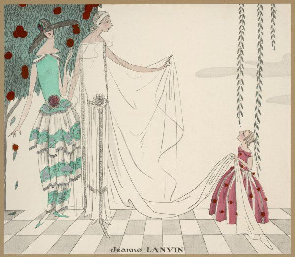 The little bridesmaid holds the train of this elegant wedding dress by Jeanne Lanvin