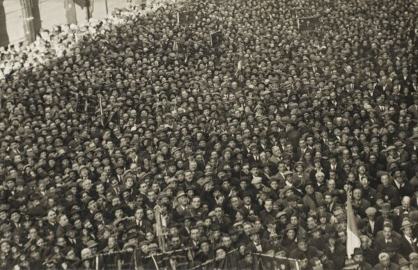 A wonderful shot of a large crowd in Rome, Italy listening to a speech by Benito Mussolini. Date: December, 1927