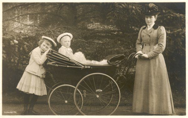 PRINCESS MARY later VISCOUNTESS LASCELLES as a child, with her brother Prince Henry (later Duke of Gloucester) in the pram, and their nanny on the right